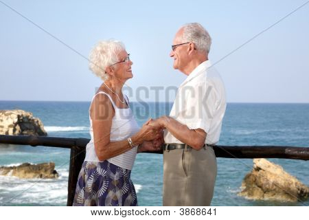 Happy Elderly Couple Holding Hands