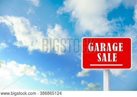 Sign With Phrase Garage Sale And Blue Sky