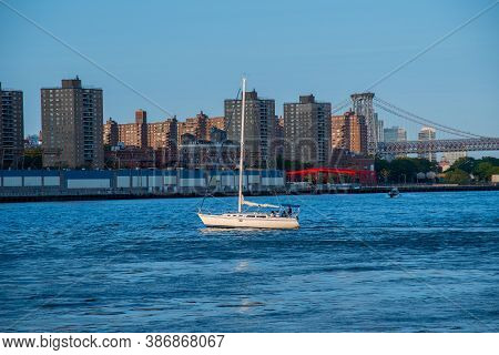 Boat On The Backgraund Of Manhattan Manhattan Skyline Foreground And Ferry Boat In The Background