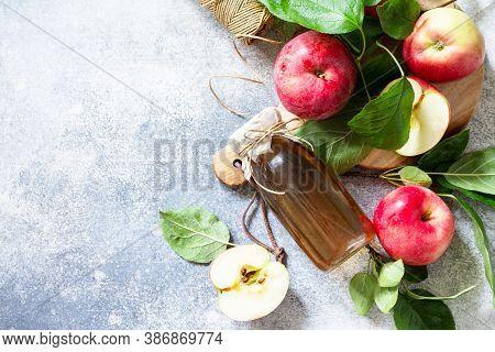 Apple Vinegar. Healthy Organic Food. A Bottle Of Apple Cider Vinegar On A Light Stone Countertop. To