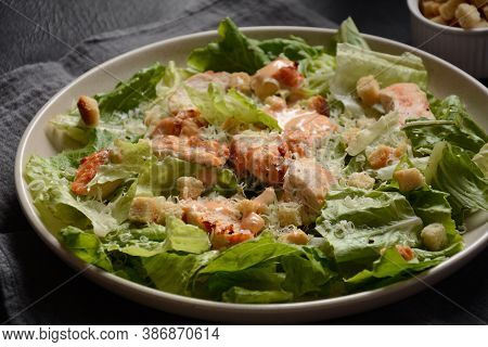 Caesar Salad With Grilled Chicken, Cheese And Croutons With Lettuce, On Plate.  Grilled Chicken Brea