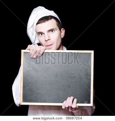 Young Male Cook With Copyspace Menu Chalk Board