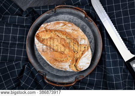 Rustic European Spelt Flour Loaf Of Bread On Iron Tray