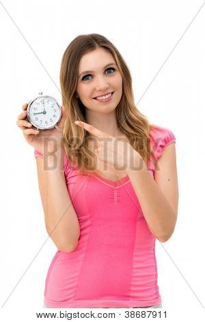 Wait,young beautiful woman holding a clock on a white background