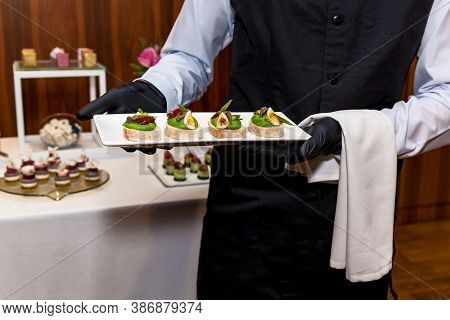 Catering, Various Delicious Snacks And Desserts On Buffet Plates. Catering, Assorted Snacks On Plate