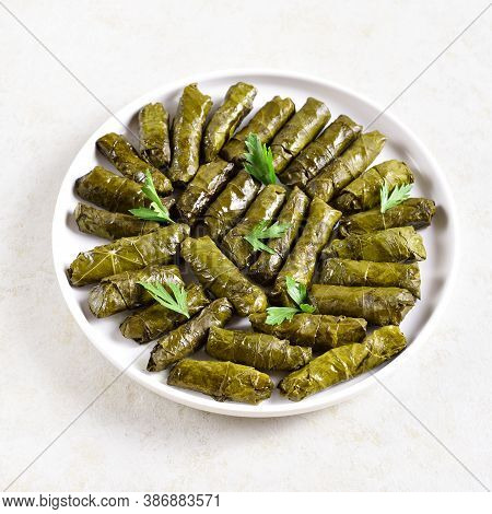 Cose Up View Of Dolma, Stuffed Grape Leaves With Rice And Meat On Light Stone Background.