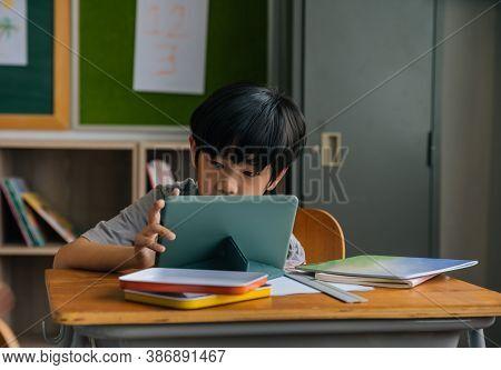 Asian School Boy Using Digital Device In School Classroom, Digital Native, Technology, Learning, Tou