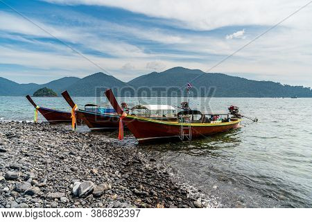 Beautiful Rock Beach With Tourist Logn Tail Boat In Koh Hin Ngam, Tarutao National Park, Thailand.