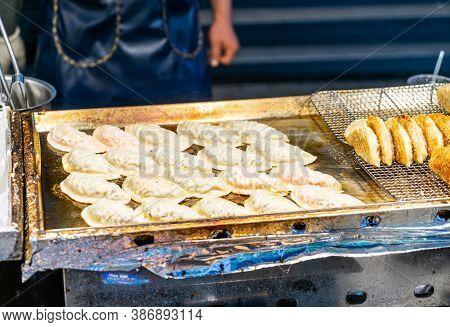 Mandu Dumpling - Traditional Korean Pan-fried Dumpling Street Food.