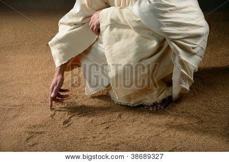 Jezus schrijven in het zand met vinger