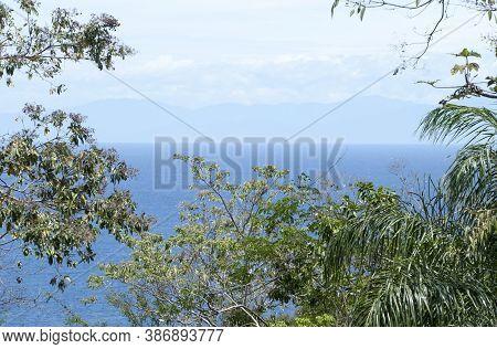 The Framed View From Roatan Island Of Honduras Mountainous Mainland.