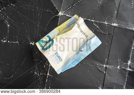 Crumpled Twenty Euro Banknote On Crumpled Black Wrinkled Paper Close Up