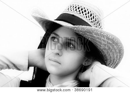 Teenage girl with beige hat