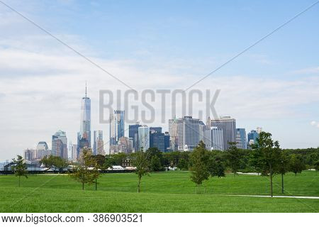 A View Of Financial District In Lower Manhattan Seen From Governors Island. Aerial Of Downtown Manha