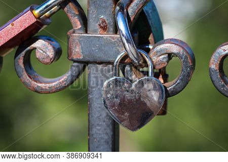 Love Padlock In Heart Shape Attached To The Railing In Warsaw, Poland