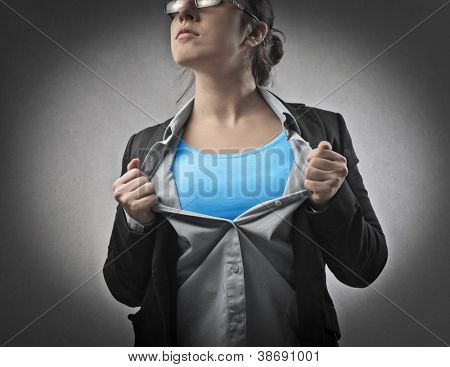 Businesswoman opening his shirt like a superhero