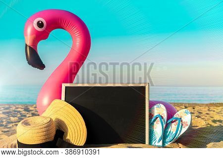 Tropical Background. Funny Pink Toy Flamingo With Blackboard, Slippers And Hat For Text On Summer Oc