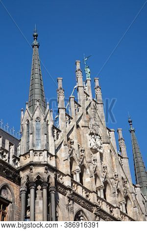 Main square of the Munich, Germany - Marienplatz (Marian square). The old and new city halls, Marian column, church Frauenkirche and Fish's fountain together are located on the square