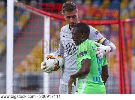 Kyiv, Ukraine - August 5, 2020: Goalkeeper Koen Casteels And Defender Wout Weghorst Of Vfl Wolfsburg