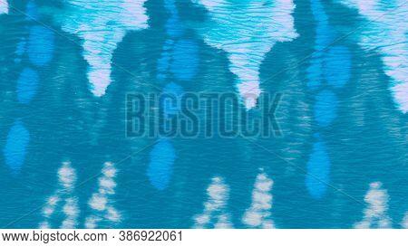 Blue Teal Ikat Design. Tie Dye Batik Style. Paint Watercolor Stains. Dirty Paper Texture. Ikat Desig