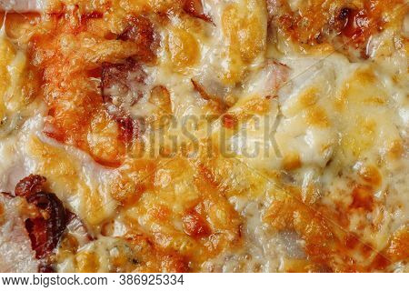Pizza With Cheese, Sauce And Ham, Bacon, Salami On A Gray Dark Background