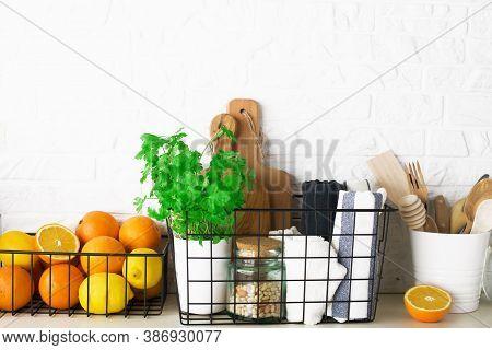 Shelf In A White Kitchen With Fresh Fruits, Herbs, Cutlery, Kitchen Utensils, Tools, Textiles, Fresh