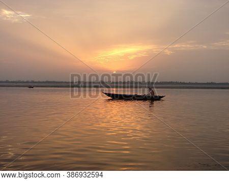 A Boat On River Ganges On Golden Morning At Varanasi
