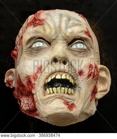 Undead Zombie Face Mask Isolated Against Black Background