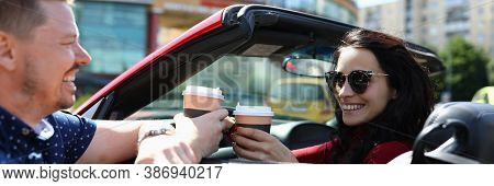Woman In Car Holds Coffee And Laughs With Man. Positive Communication Between Couples On Dates Conce
