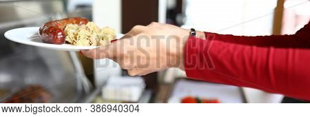 Woman Is Holding Plate Of Food In Bistro. Self Service In Cafes And Restaurants Concept
