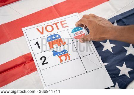 Maski, India 17, September 2020 : Hands Placing I Voted Sticker On Republican Party Symbol - Concept