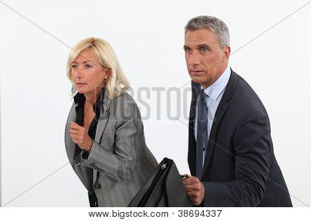 Businessman and businesswoman ready to race
