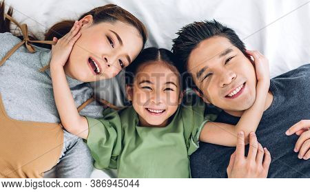Top View Of Portrait Enjoy Happy Smiling Love Asian Family Father And Mother With Young Parents Litt