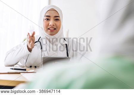 Muslim Asian Female Doctor Consulting And Check Up Information With Muslim Woman In Hospital.woman H