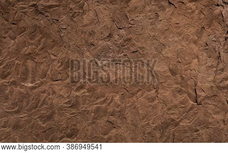 Red Brown Granite Texture.granite Rock. Selective Focus. Rusted Background. Rock Wall Backdrop With