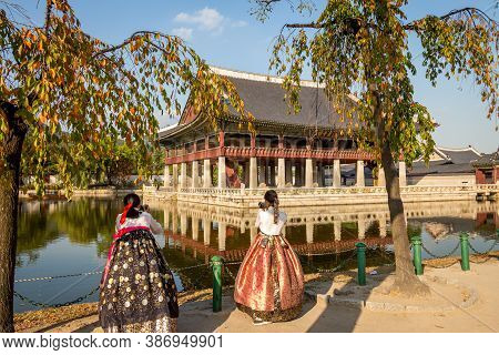 Seoul, South Korea - October 19th 2017: Women Dressed In Hanbok Traditional Dresses By The Lake At G