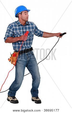 Manual worker with a set of jump leads