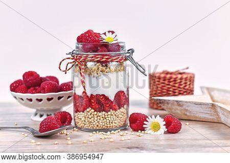 Healthy Raspberry Fruit Dessert With Skyr Yogurt,  Granola And Puffed Quinoa Grains Layered In Jar S