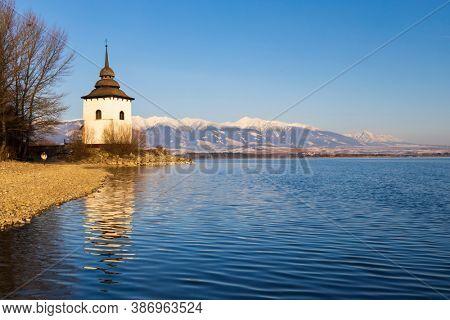 Church of Virgin Mary in Havranok and lake Liptovska Mara, district Liptovsky Mikulas, Slovakia
