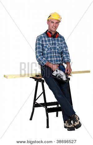 craftsman cutting a board