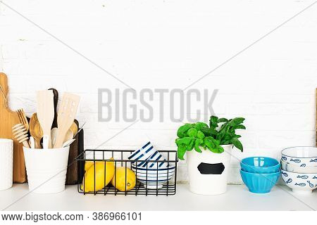 Kitchen Table Shelf With Cutlery, Spoons, Spatulas, Fresh Basil, Cutting Boards, Fresh Vegetables, L