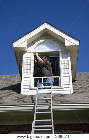 Painter Painting Trim Around Doors Windows