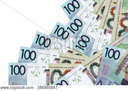 100 Belorussian Rubles Bills Lies In Different Order Isolated On White. Local Banking Or Money Makin