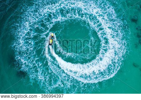 People Are Playing A Jet Ski In The Sea.aerial View. Top View.amazing Nature Background. The Color O