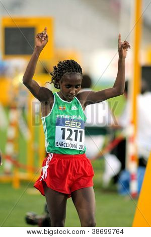 BARCELONA - JULY, 11: Ruti Aga of Ethiopia celebrates his silver medal of 5000 meters event of the 20th World Junior Athletics Championships at the Olympic Stadium on July 11, 2012 in Barcelona, Spain
