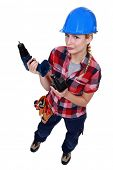 Tradeswoman holding a battery-powered power tool poster