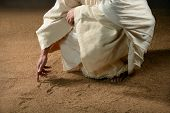 Jesus writing in the sand with finger poster
