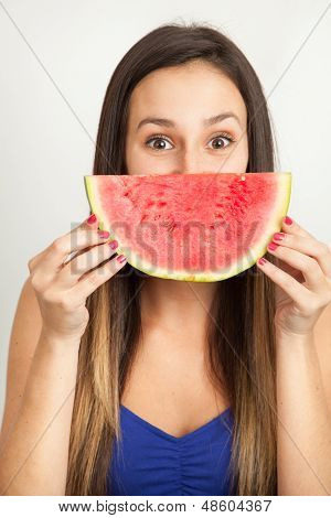 Portrait Of A Young Woman Smiling With Water Melon