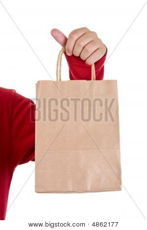 Man Hand Holding Papper Bag