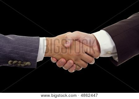 Business Hand Shaking On A Black Background